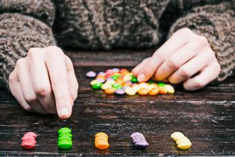 candy buttons and hands
