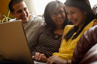 Family playing game on laptop