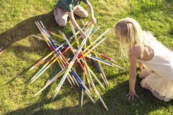 Kids playing giant pick up sticks