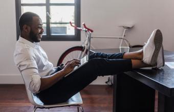 Man using laptop in home