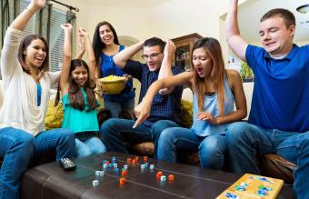 friends playing competitive dice game