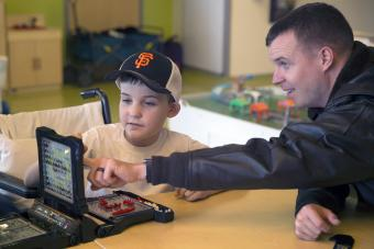 U.S. Navy Capt. plays the board game Battleship with a kid
