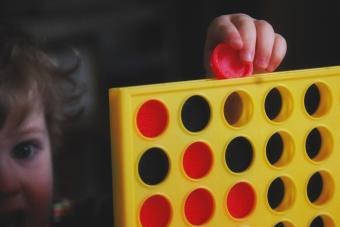 Girl playing Connect Four