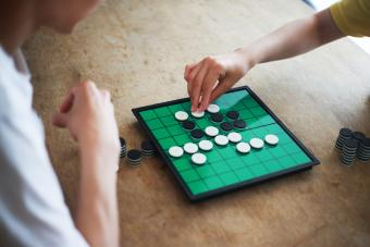 Couple playing Reversi (Othello) board game