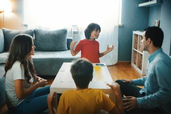 Family playing Moods Board Game