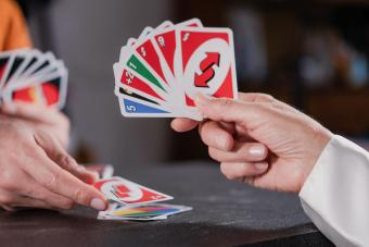 Friends playing UNO cards