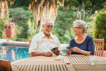 Senior Couple playing cribbage outdoors