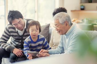 Family using digital tablet together at home