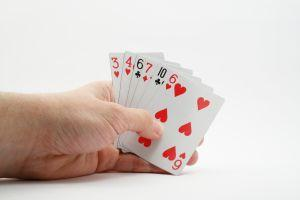 A hand holding cards
