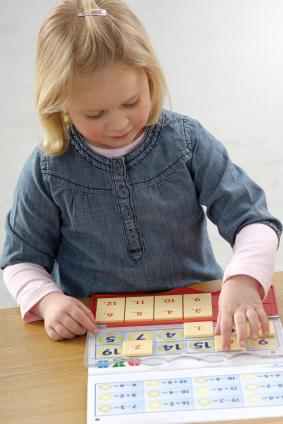 Girl playing math game
