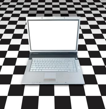 Laptop on a checkerboard