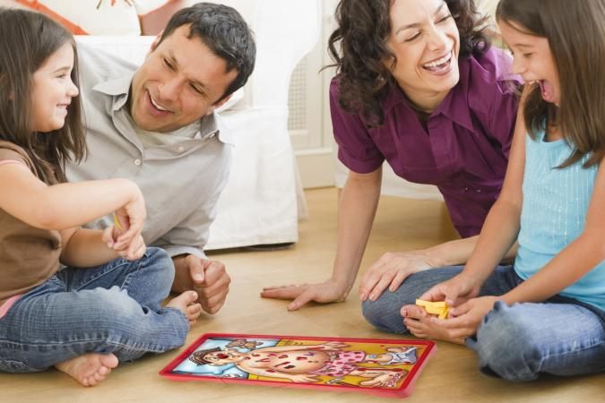 playing game in livingroom with children