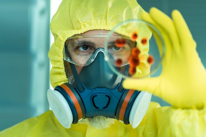 Man with dangerous viruses in laboratory