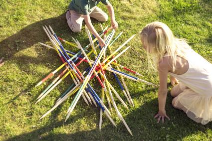 Kids playing giant pick up sticks