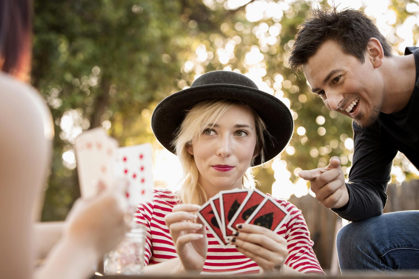 Friends playing card game in the park