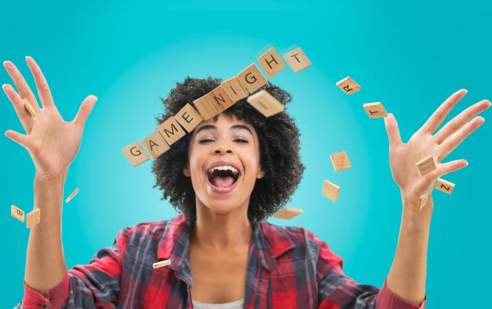 Woman tossing Scrabble letter game pieces