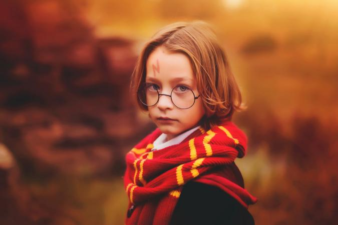 Boy dressed in Harry Potter style