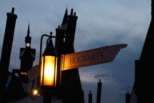 Hogwarts sign on guidepost in town