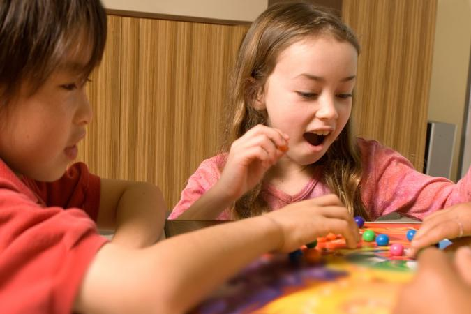 Kids playing marble board game