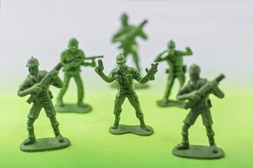 Green plastic soldier toy pieces
