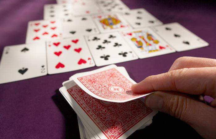 man playing a card