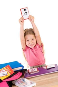 child holding up flash cards