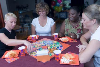Women playing Trivial Pursuit