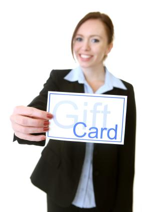 Business woman with gift card