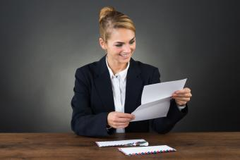 woman reading business letter