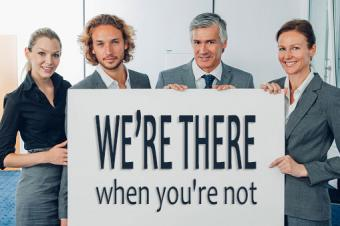 Business team holding billboard