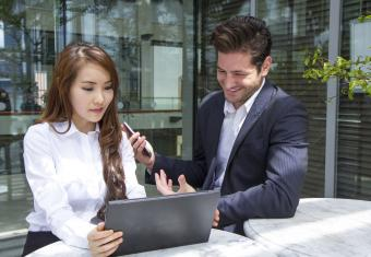 Consultant helping businesswoman with plan