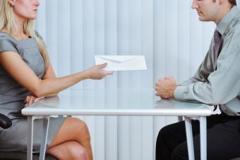 woman handing man termination letter