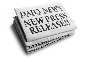 Newspaper with press release headline