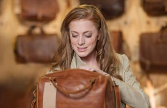 Woman looking at leather bag