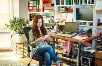 Woman sitting in home office