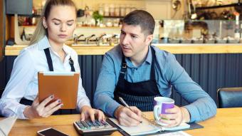Restaurant owners discussing finances