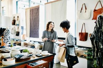business owner with customer in boutique shop