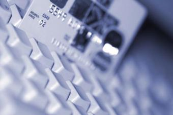 Credit card propped on laptop keyboard