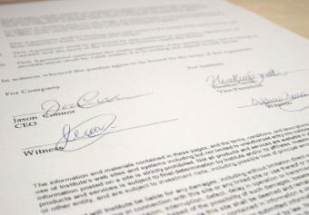 Business contract signed according to employment laws