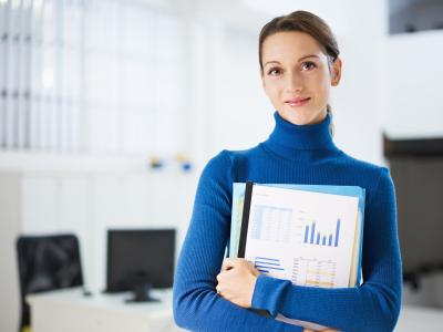 Woman holding a business report