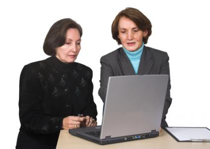 Business women searching for a loan online; © Andres Rodriguez | Dreamstime.com
