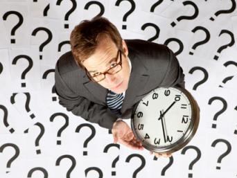Businessman holding a clock