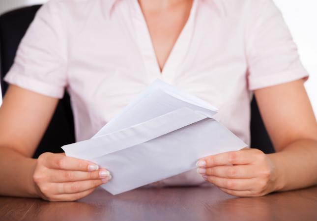 business woman with letter and envelope