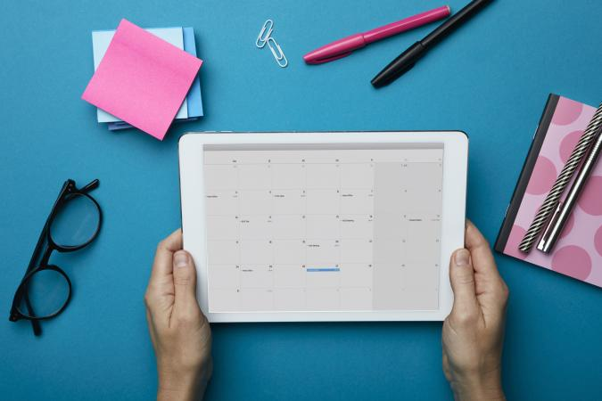 holding tablet with calendar