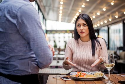 Woman complaining about food quality in restaurant