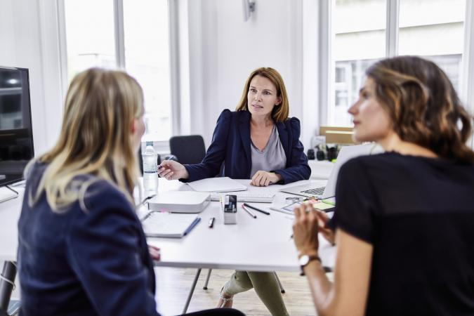 Three businesswomen having a meeting in office