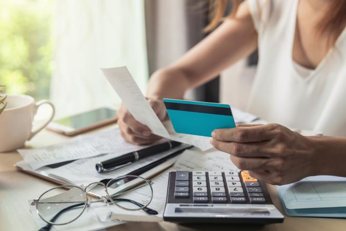 Businesswoman Holding Credit Card And Bill