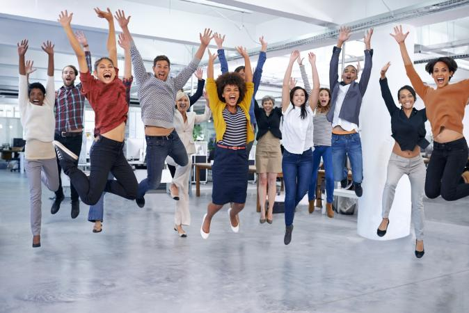 Office staff jumping and celebrating at work