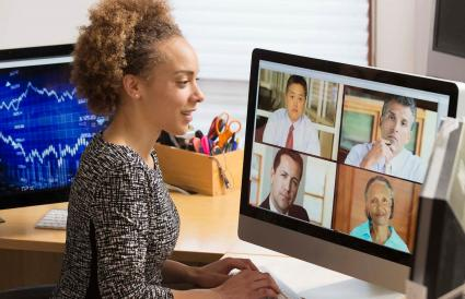 Businesswoman teleconferencing from home