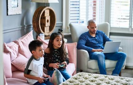 Children playing with games console